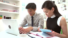 Asian Couple Working From Home Looking At Personal Finances - stock footage