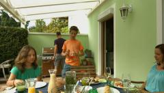 barbecue grilling out on terrace - stock footage