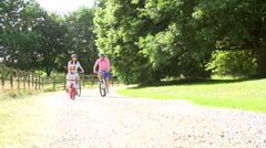 Asian Family On Cycle Ride In Countryside - stock footage