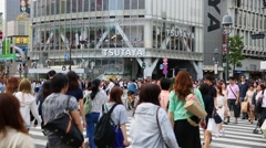 Pedestrians crossing the busiest crosswalk in Tokyo, Japan Stock Footage