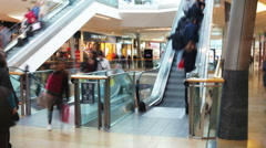 Time Lapse Sequence Of Shoppers On Escalators In Mall Stock Footage