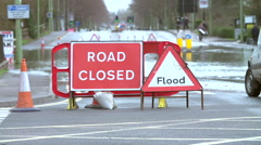 Stock Video Footage of Sign Warning Of Road Closure Due To Flooding