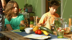 Children eating on veranda Stock Footage