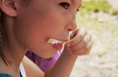 Girl with ice lolly - stock photo