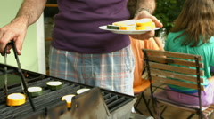 Detail putting vegetables on grill Stock Footage