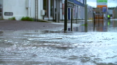 Slow Motion Sequence Of Flood Water Flowing Into Street Stock Footage