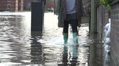 Slow Motion Sequence Of Boots Walking Along Flooded Road Stock Footage
