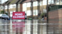 Sign Warning Of Road Closure Due To Flooding Stock Footage