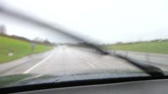 Rainy Car Journey Viewed Through Windscreen - stock footage