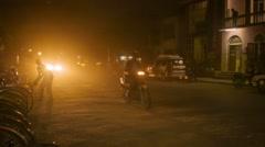 Bagan, myanmar - 11 jan 2014:  burmese asian dusty road trafic at night with  Stock Footage