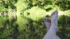 Bare Feet Floating Oregon River 1 - stock footage