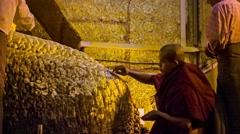 Mandalay, myanmar - 13 jan 2014: people put golden leaves on mandalay maha my Stock Footage