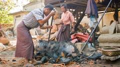 Mandalay, myanmar - 13 jan 2014: bronze statue production in open-air worksho Stock Footage