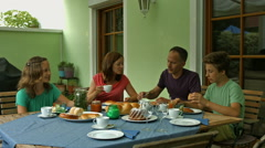 Family eating sweet austrian snacks on veranda Stock Footage