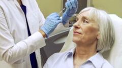 Woman Having Botox Treatment At Beauty Clinic Stock Footage