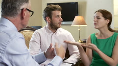Young Couple Talking To Male Counsellor Stock Footage