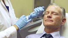 Man Having Botox Treatment At Beauty Clinic Stock Footage