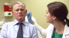 Cosmetic Surgeon Discussing Proceedure With Client In Office Stock Footage