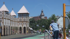 Children in playground having fun, nice toy castle, parents with kids outside  Stock Footage