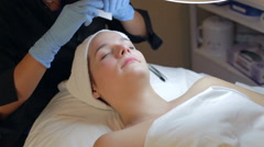 Woman Having Eyebrow Shaping Treatment At Spa Stock Footage