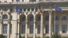 Romanian national flag, European Union flag, NATO flag waving outside Parliament Stock Footage
