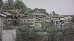 Neglected ride at abandoned theme park. 0554 Stock Footage