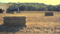 Tractor Drive By in Field Stock Footage