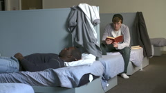Men Lying On Beds In Homeless Shelter Stock Footage