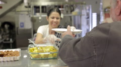 Kitchen Serving Food In Homeless Shelter - stock footage