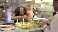 Kitchen Serving Food In Homeless Shelter Stock Footage