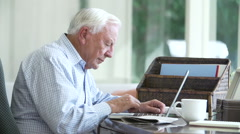 Senior Man Finding Phone Number Of Company Online Stock Footage