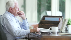 Senior Man Reading Letter From Keepsake Box Stock Footage