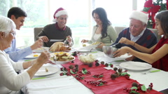 Multi-Generation Family Enjoying Christmas Meal Together Stock Footage