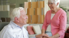 Senior Couple Reading Letter From Keepsake Box Stock Footage