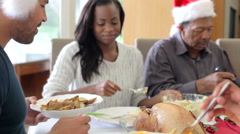 Multi-Generation Family Enjoying Christmas Meal Together - stock footage
