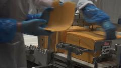 Cheese cutting industrial volunteers for charity 4K 018 Stock Footage