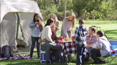 Two Families Enjoying Camping Holiday In Countryside - stock footage