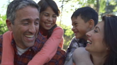 Slow Motion Sequence Of Parents Giving Children Piggyback - stock footage