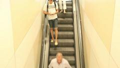 People using escalator, shopping mall, commuters, airport, train station Stock Footage