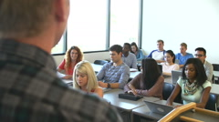 Over the Shoulder View Of University Tutor Teaching Class Stock Footage