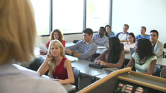 Over the Shoulder View Of University Tutor Teaching Class - stock footage