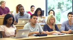 Students Using Laptops And Digital Tablets In Lecture Stock Footage
