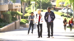 Students Walking Outdoors On University Campus Stock Footage
