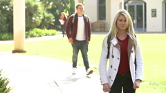 Female Student Walking Outdoors On University Campus Stock Footage