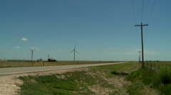 Oklahoma Panhandle power windmills and old house Stock Footage