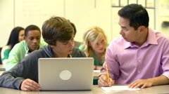 Male High School Student With Teacher Using Laptop Stock Footage
