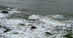 4k sparkling ocean sea water waves surface&coastal rock reef coast surge shore. Stock Footage
