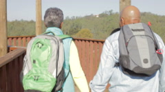 Senior Couple On Viewing Platform At The End Of Hike Stock Footage
