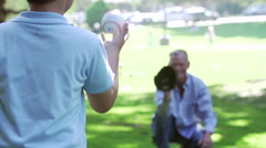 Slow Motion Shot As Grandfather Plays Baseball With Grandson - stock footage