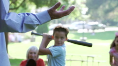 Grandparents Playing Baseball With Grandchildren In Park - stock footage